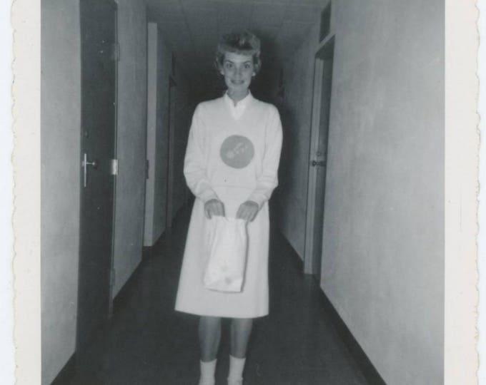 Woman in Hallway with Paper Bag, c1950s Vintage Snapshot Photo (78598)
