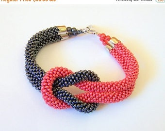 15% SALE Beadwork - Bead Crochet Bracelet in grey and red - Beaded Bracelet - Infinity Knot Bracelet - Beaded Bracelet Cuff