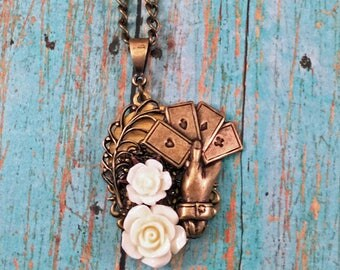 The Gambler - mini assemblage pendant with a hand of cards and roses.