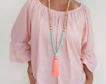 Neon Coral Tassel necklace . Long beaded tassel necklace with wooden beads, mint resin beads and a  neon coral tassel