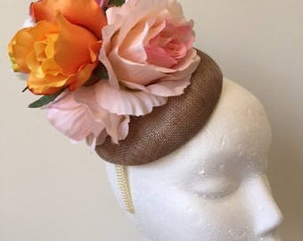 Gorgeous latte fascinator with various flowers on a cream headband!