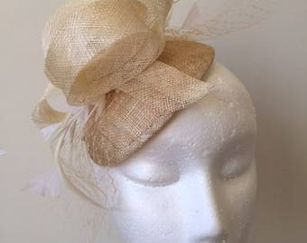 Cream sinamay fascinator with loops, netting and feathers! Gorgeous on!