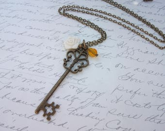 Skeleton key long necklace with flower and crystal drop