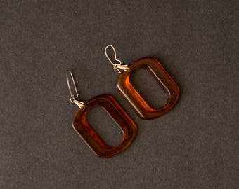 vintage bakelite dangle oval earrings
