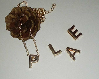 Gold necklace and her alphabetical letter
