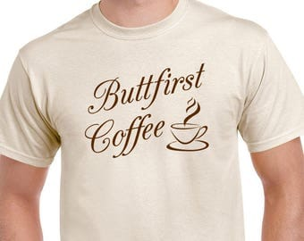 Strange fictional Buttfirst Coffee T-shirt. Funny saying coffee lover's tee. Shirt is natural in color printed in mocha brown ink.