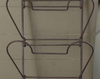 Newspaper holder made of wrought iron