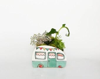 Vintage turquoise caravan vase for plants. Perfect cactus or succulent planter.