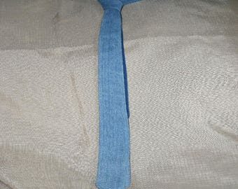 Denim tie from an old pair of blue jeans.  These ties are unique in that they are made from a clean old pair of blue jeans.