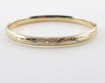 """14K Yellow Gold Bangle Bracelet 7 1/2 """" 7.50 grams Floral Diamond Cut Bangle Bracelet"""