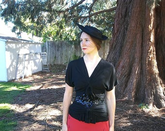 1940s black stretchy knit shirt with sequined yoke and decorative bows // small