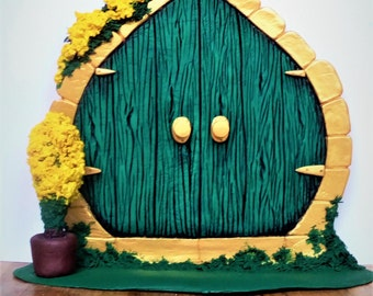 Green fairy door, large unique freestanding green and gold fairy door with yellow flowers.