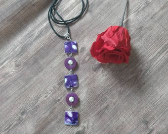 Vertical and original, purple and white mother of Pearl necklace.