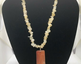 A24 Chips Jade with a Carnelian pendant