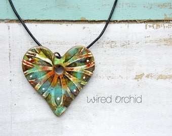 Polymer Clay Heart Pendant Jewelry featuring a Grunge Boho Flower Design in Teal, Orange, Brown and White
