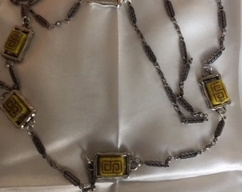Silvertone tribal motif link chain with five pineapple colored glass beads with tribal like markings- 36 inches