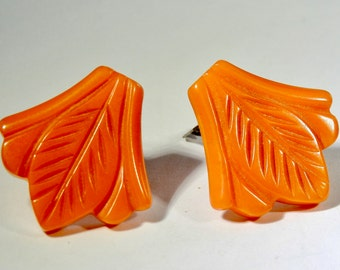 Carved Orange Bakelite Dress Clips