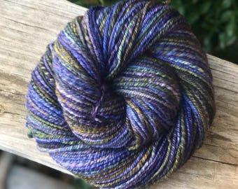 Handspun yarn, purple, green, navy, gold, and olive tones, 100% merino wool, malabrigo wool, dk weight, sport weight, three pl