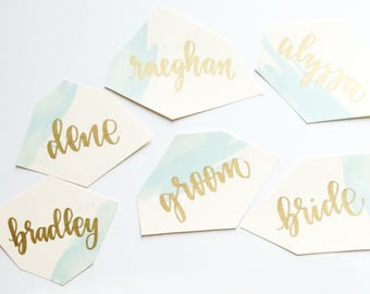 watercolor calligraphy place cards // handwritten gem shaped boho place cards in gold and silver pen // geode wedding stationery