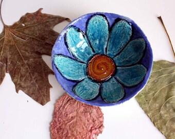 Ceramic bowl decorated with a flower, handmade bowl, home décor.