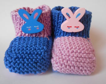 Mismatched pink and blue Easter bunny slippers