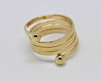 Plated gold mounted as a spring ring