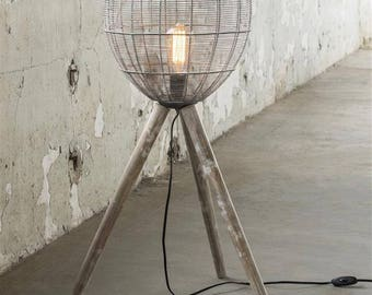 Vintage Industrial Style Grey Cage Floor Lamp on wooden tripod legs.