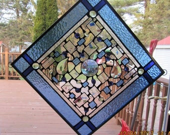 sky blue purple accented stained glass window hanging