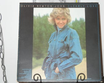 "Olivia Newton John Clearly Love Vintage Vinyl Album featuring the songs ""Something Better to Do"" and ""He Ain't Heavy...He's My Brother"""