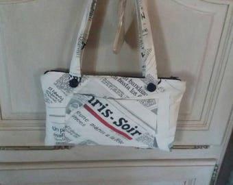 Black and white newspaper print clutch bag