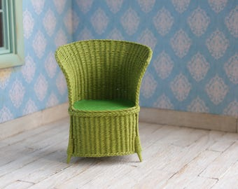 A miniature handwoven green armchair