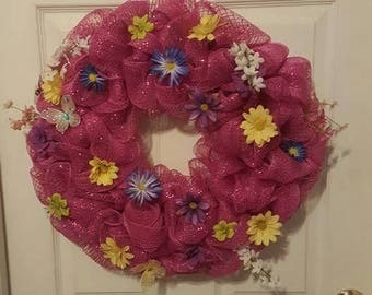 Beautiful pink mesh wreath with flowers