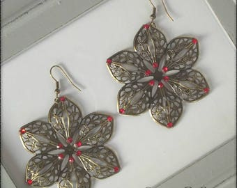 Bronze earrings dangle a red flower with 6 petals with Rhinestones