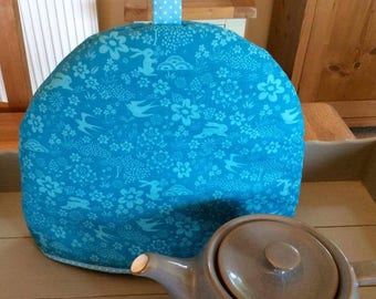 Tea cozy, tea cosy in a gorgeous jewel blue with turquoise rabbits, swallows and flowers print. Fits a four to six cup teapot.