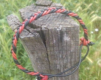 Leather Bracelet braided flat red and black and Red crow bead
