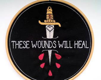 Embroidery hoop wall art / home decor, hand finished dagger illustration