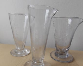 Three Victorian Glass Apothacary Measures