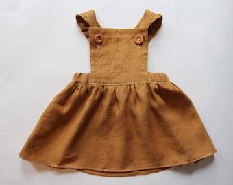 Handmade girls mustard pinafore dress. Girls linen dress. Summer dress. Toddler dress. Mustard dress. Washed linen. Linen dress.