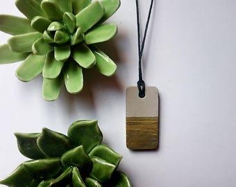 Concrete necklace gold