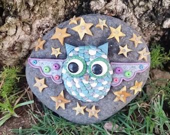 Blue owl flying through starry night