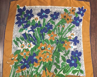 Vintage Vera Neumann floral silk and rayon scarf in blue and copper shades. Striking vintage Vera floral scarf