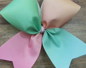 Pastel Rainbow cheer bow made with 3 inch wide ribbon and ponytail holder