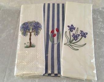 A trio of floral machine embroidered tea towels kitchen towels