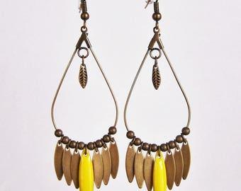 Dangle drop earrings and lemon yellow enameled shuttle