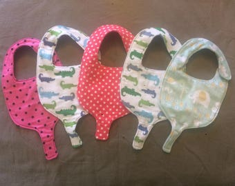 Baby bib pacifier holder.
