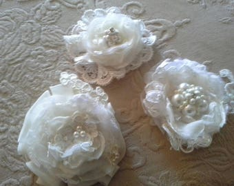 Handmade flowers  creams and whiteswedding embellishments, rhinestones, pearls applique