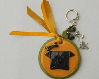 Key chain dog ochre black polymer