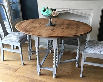 Now sold!       Cottage style oak dining table with two chairs