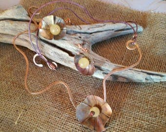 """Desert Flowers"" necklace and copper-forged earrings"