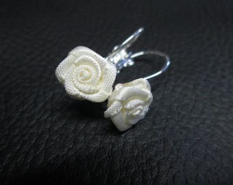 Stud Earrings with a small ivory rose